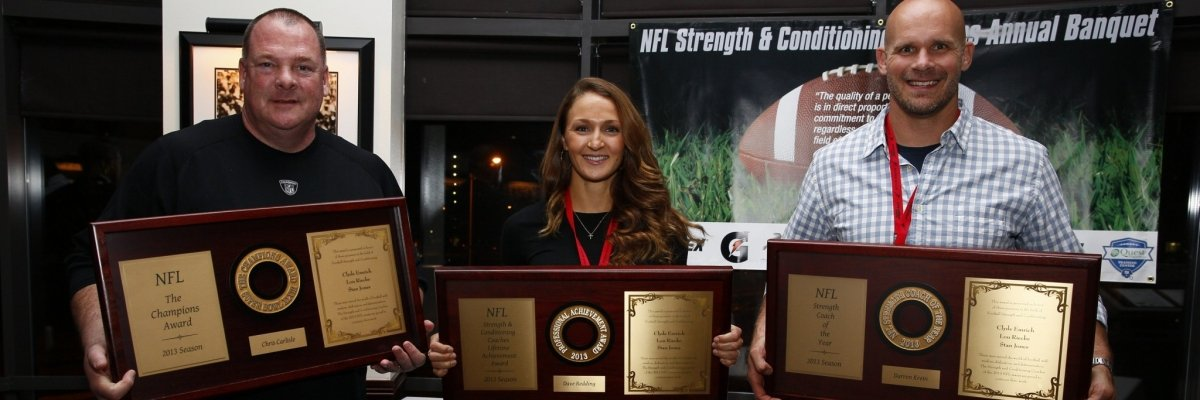 photo of Chris Carlisle, 2013 Champions Award winner, Taylor Redding Barryhill, receiving the 2013 Lifetime Achievement Award on behalf of her father, Dave Redding, and Darren Krein, 2013 Strength Coach of the Year Award winner