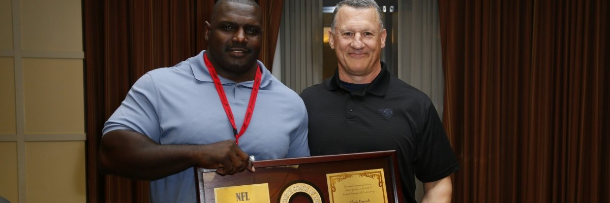 photo of Cedric Smith receiving the 2012 Strength Coach of the Year Award, presented by Rock Gullickson